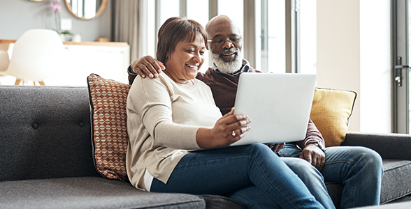 https://assetlibrary.securian.com/content/dam/img/email/hero/ehb-mature-couple-grandparents-laptop-facetime-happy-home-couch-african-american-052220-dp.jpg